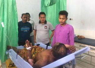 Kapolres Raja Ampat, AKBP Edy Setyanto Erning, SIK menjenguk korban kebakaran di RSUD Wisai, Minggu (22/7/2018)